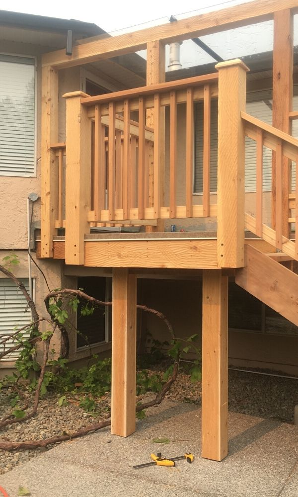 Landing of the stairs for the rustic deck design